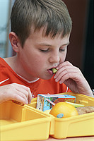 boy eating packed lunch