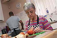 Woman and carer cooking